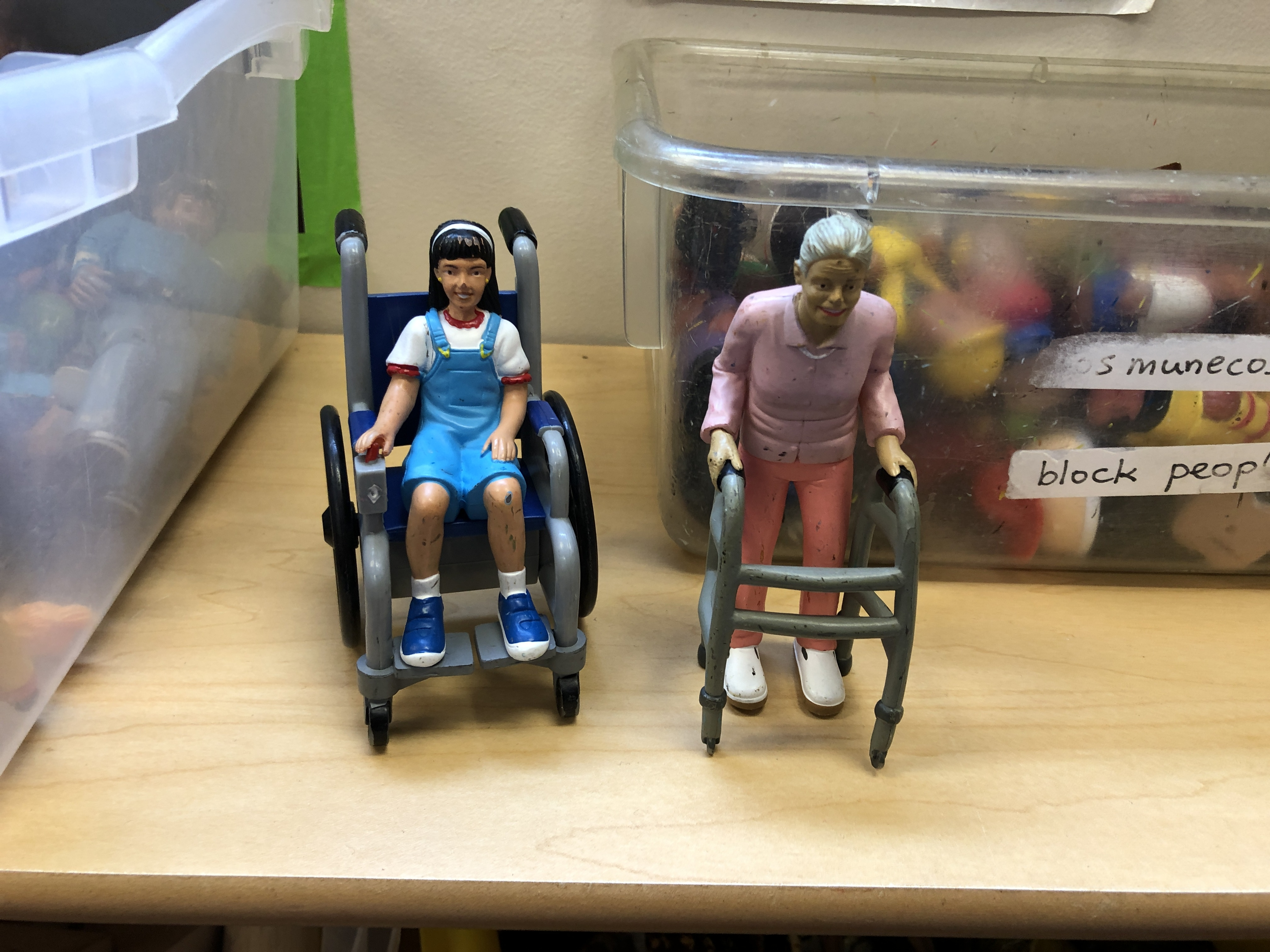 toy figurines in wheelchairs
