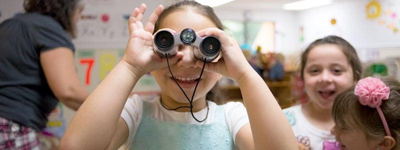 Girl with a CLASS lens binocular