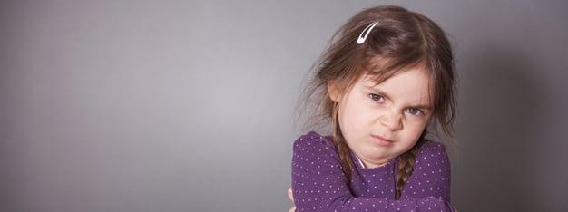 A young girl throws a temper tantrum