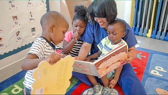 A nursery school teacher interacts with young children after her classroom was observed.